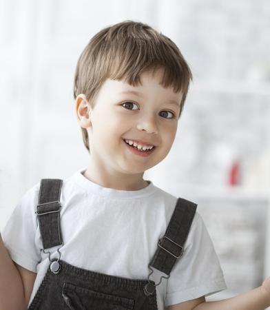 handcarves: cheerful boy indoors