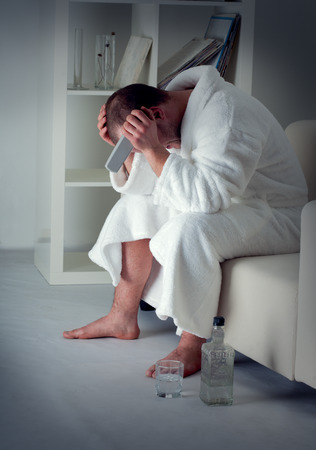 sad man alone: sad man alone in a room Stock Photo