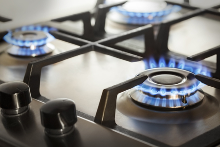 combust: kitchen gas cooker with burning fire propane gas