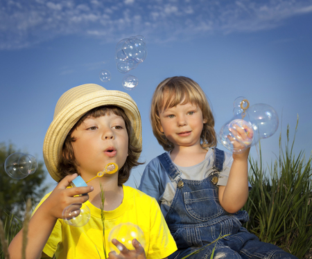 boys playing: boy play in bubbles
