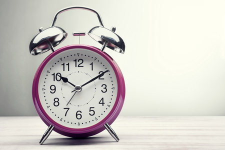 classic green alarm clock morning wake-up time Stock Photo