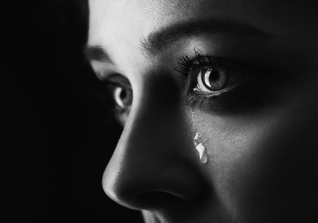 sad face: beauty girl cry on black background (height contrast film monochrom edit)