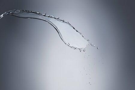 liquid splash: Abstract Splash of Water on a Blue Background