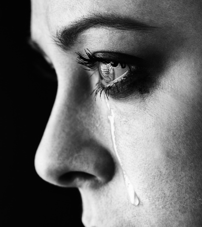 tears: beauty girl cry on black background