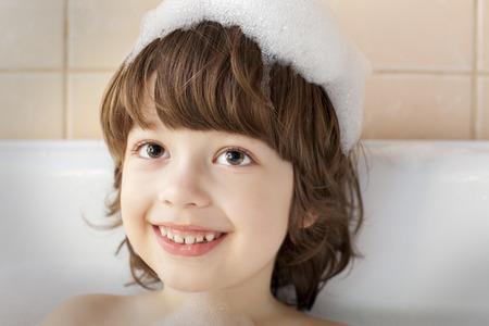 happy boy in bathtub