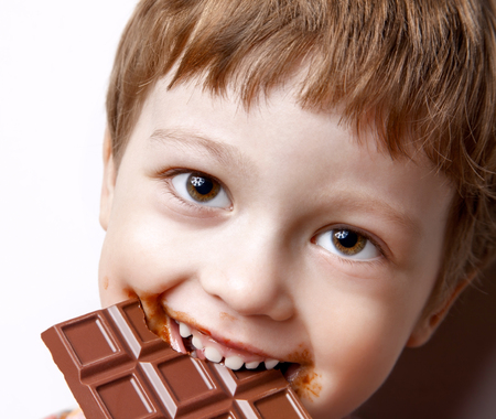 sweet smile: happy boy with chocolate bar