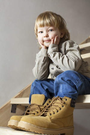 Big shoes to fill, childs feet in the large shoe