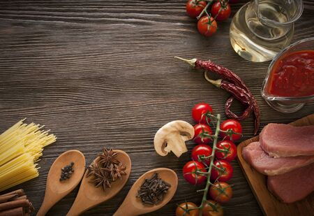 tomato sauce: everything on wood table for the cooking of acute Italian sauce (tomato garlic spices olive oil) Stock Photo