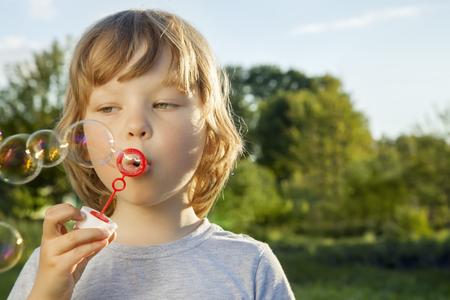 boy beautiful: boy play in bubbles