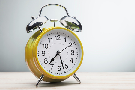 12 oclock: classic green alarm clock morning wake-up time Stock Photo