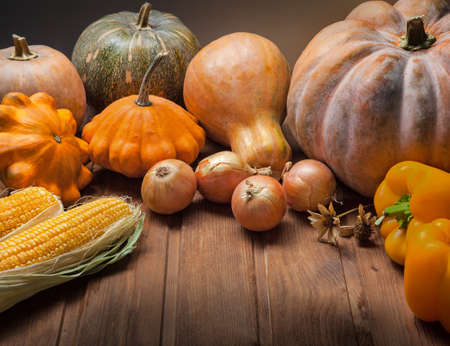 autumn pumpkins and other fruits and vegetables on a wooden table Stock Photo