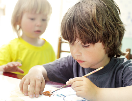 one room school house: Two Children draw in home, Boys studying drawing at school