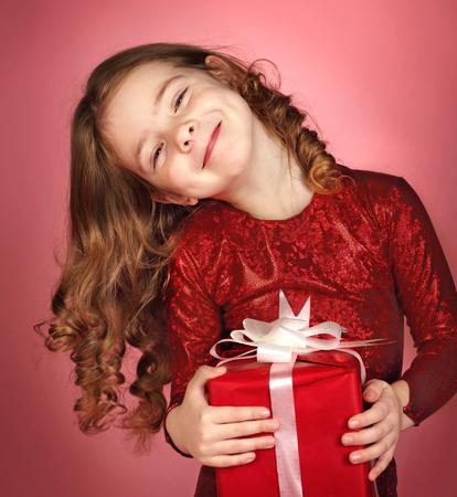 Happy little girl with christmas gift box photo