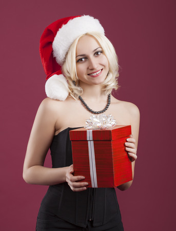 christmas woman: beauty girl with red gift box Stock Photo
