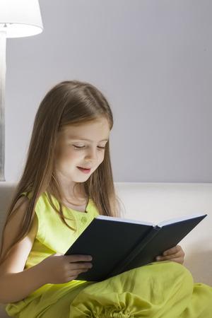 beauty girl read book on sofa photo