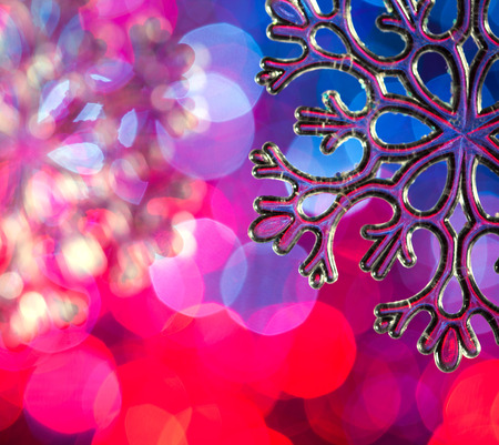 igniting: toy snowflake on a background of Christmas lights