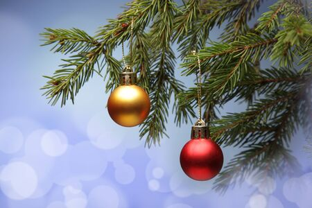 Twigs: Christmas Tree and decorations on illuminations background space for lettering Stock Photo
