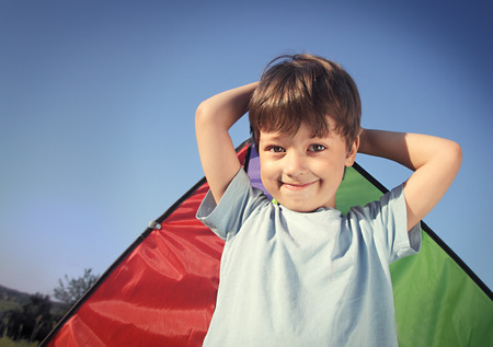 happy boy with kite outdoors