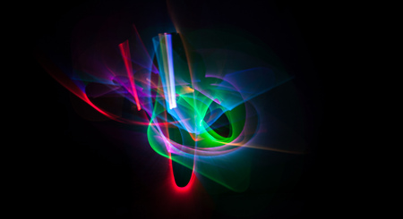 internet icon: Abstract line motion of different colors, curves abstraction color explosion. Unrecognizable figure. Expressive sketch on a black background isolated