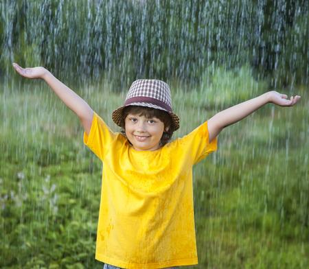 happy boy in rain summer outdoors