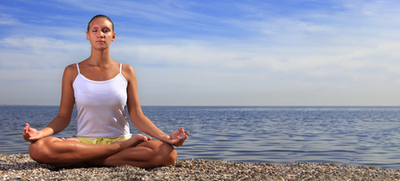 beauty girl on beach in lotus pose, yoga relax