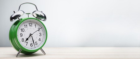 torn metal: classic green alarm clock morning wake-up time Stock Photo