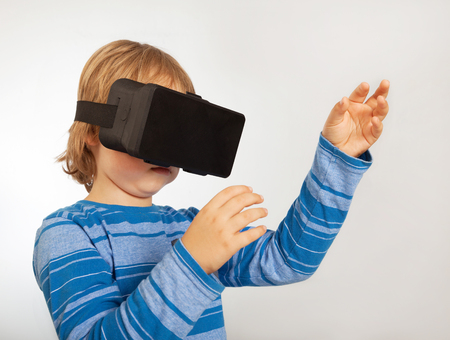 tries: boy with glasses of virtual reality, the child tries new technology