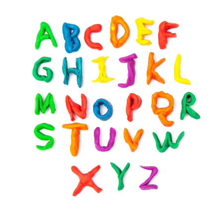 English alphabet crocheted from plasticine child on white background isolated, polymer clay multicolored letters