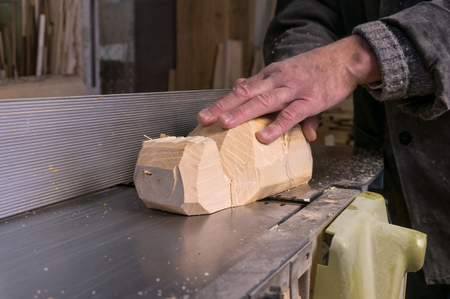 whittle: carpenter at work, jointing of wood Stock Photo