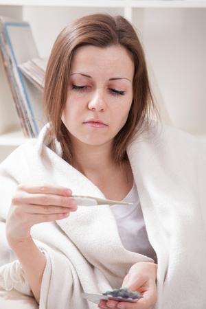 sniffles: Girl mereet temperature at cold Stock Photo