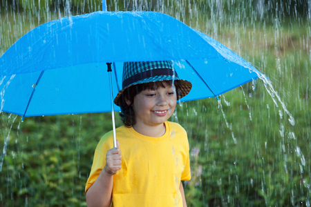 multi age: happy boy with umbrella outdoors, child with an umbrella walks in the rain