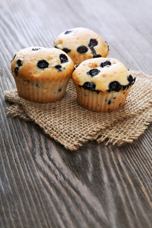 sweet pastries: muffin with blueberries on a wooden table. sweet pastries on the board