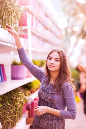 beauty girl shoping green plant photo