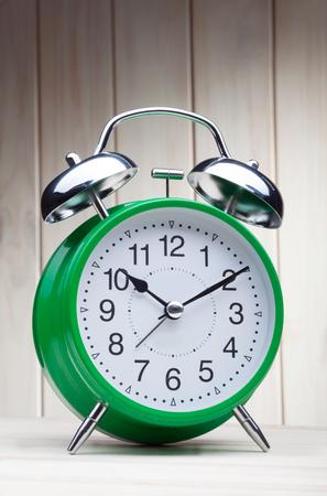 classic green alarm clock morning wake-up time Stock Photo