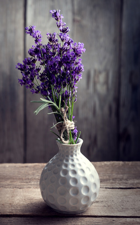 lavender coloured: Bouquet of summer lavender on an old wooden background. (top view)