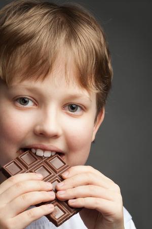 happy boy with chocolate bar