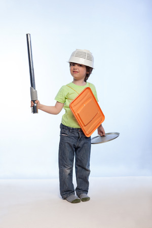 lords: boy playing knight using cookware isolate on white Stock Photo