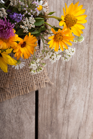 Bouquet of wild flowers vintage board. Banco de Imagens