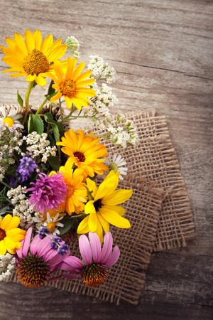 Bouquet of wild flowers vintage board. Stock Photo