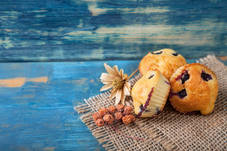muffin with blueberries on a wooden table. sweet pastries on the board