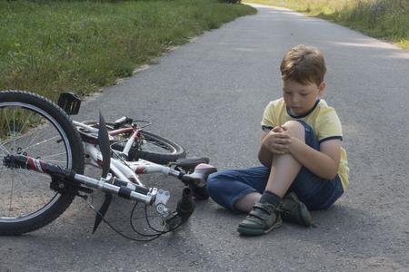 fell down of his first bike on road. Reklamní fotografie