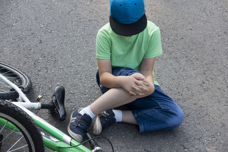 Fell down of his first bike on road.