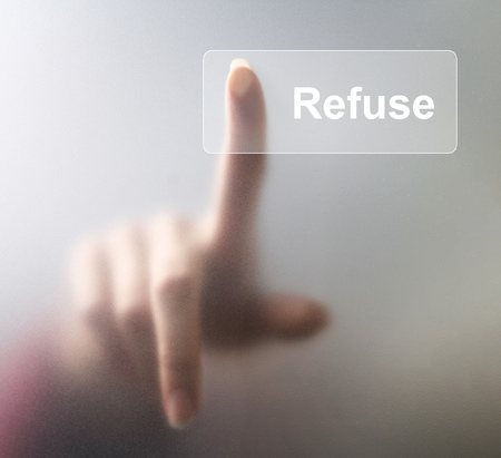 Refuse button. Woman finger pressing a glass refuse button on grey