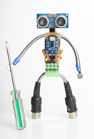 Robot made of parts of circuit boards, isolate on white.
