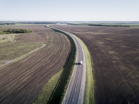 Top view of the field road with car. Aerial. Reklamní fotografie