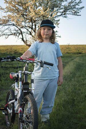 the happy boy ride bikes summer outdoors Stock Photo