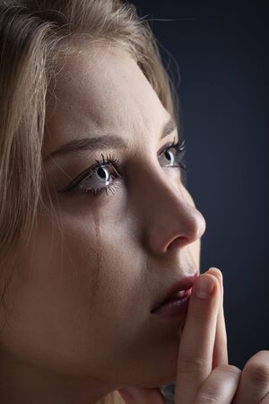 Close up eye woman crying with tears Imagens