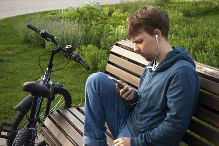 Young Teenager Man With Smartphone And Bike.