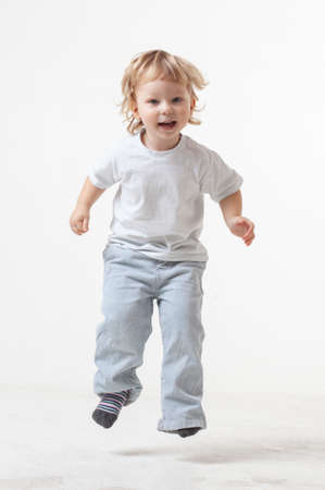 happy child jumping on white background 免版税图像