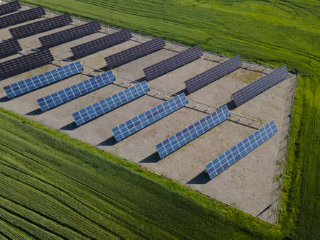 Solar Panels in summer field. Aerial industrial view